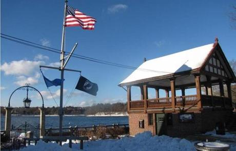 Flags flew on the edge of Jamaica Pond.